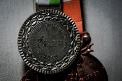 Medali Juara 2 Warnadi yang diraih saat berlaga bersama Garuda-INAF di gelaran 8th Pan Disability Football Championship 2018 Malaysia. Selain itu, dua medali lain di belakang merupakan raihan Warnadi saat turut serta dalam Kartini Run tahun 2018 dan 2019.